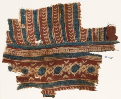 Textile fragment with linked diamond-shapes and chevrons
