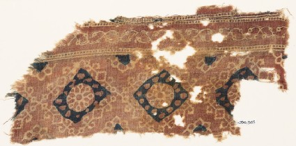 Textile fragment with ornate rosettes and squares