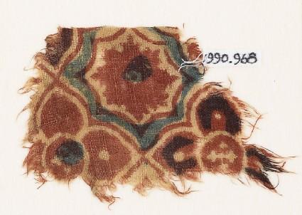 Textile fragment with linked quatrefoils