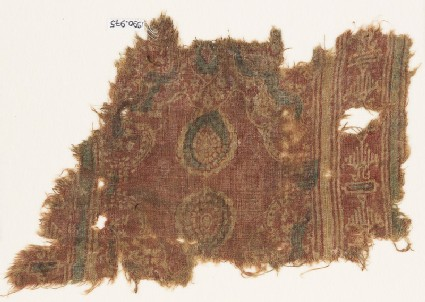 Textile fragment with ovals and possibly stylized birds
