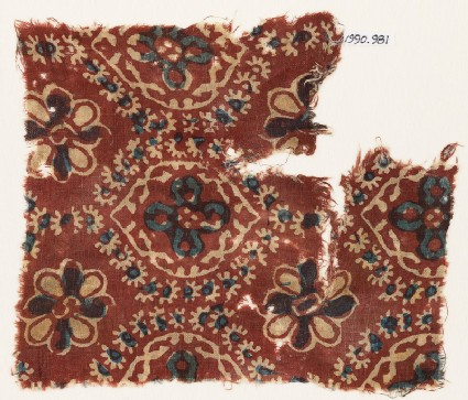 Textile fragment with pointed ovals and rosettes