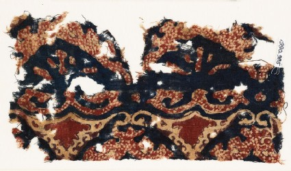Textile fragment with tendrils and possibly leaves
