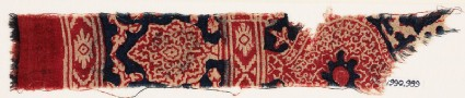 Textile fragment with oval medallion and possibly a tree