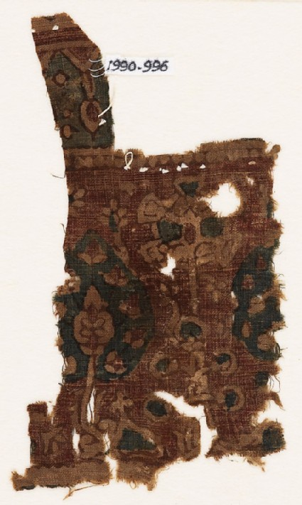 Textile fragment with trees and flowering bush