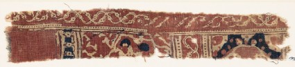 Textile fragment with interlacing vines and possibly medallions