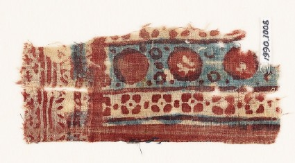 Textile fragment with circles and quatrefoils