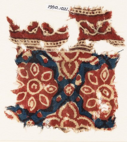 Textile fragment with flowers and trefoils