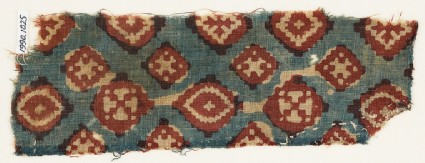 Textile fragment probably imitating patola pattern, with diamond-shapes and crosses