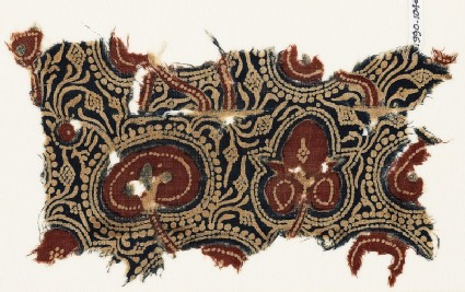 Textile fragment with plants, tendrils, and fruit