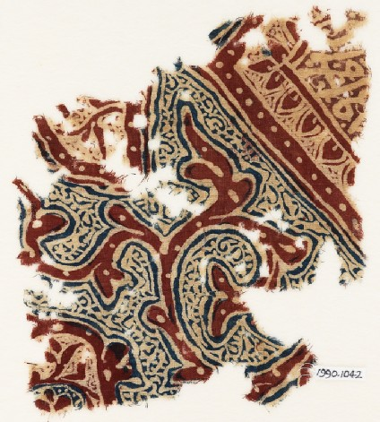 Textile fragment with tendrils and script