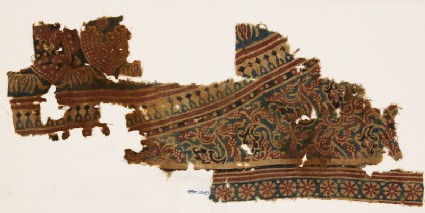 Textile fragment with tendrils, leaves, and rosettes