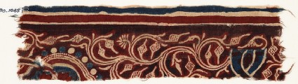 Textile fragment with vine, tendrils, and fruit