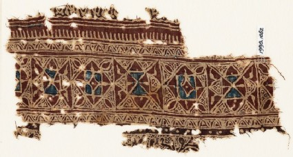 Textile fragment with interlocking squares and triangles