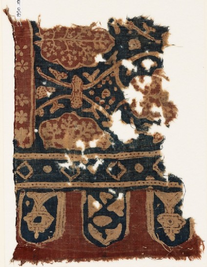 Textile fragment with linked tendrils, stylized trees, and tabs