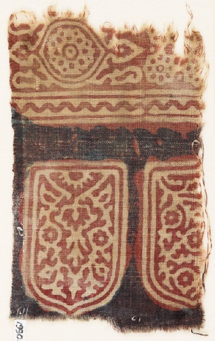 Textile fragment with tab-shapes, linked rosettes, and an oval