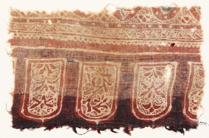 Textile fragment with tab-shapes and plants