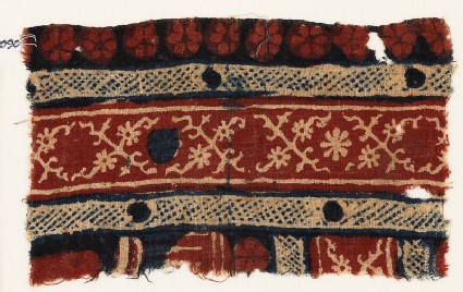 Textile fragment with crossed tendrils and rosettes