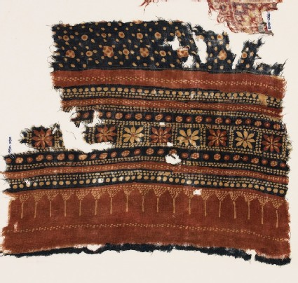 Textile fragment with bands of flowers and dots