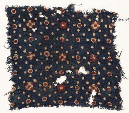 Textile fragment with dots and rosettes