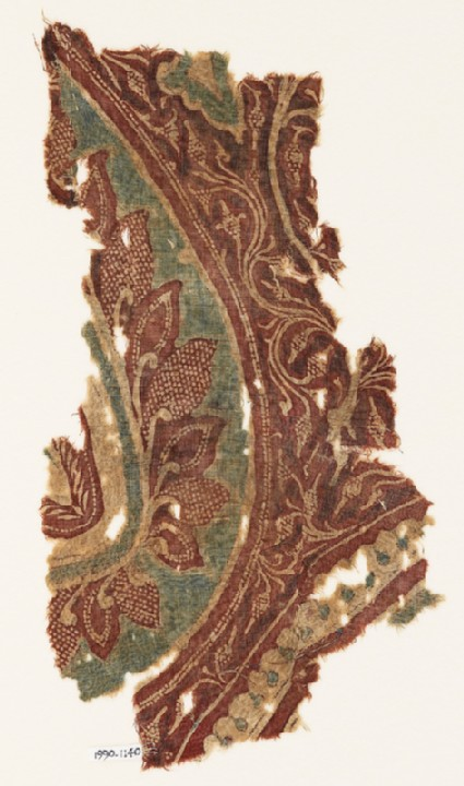 Textile fragment with part of a large leaf, tendrils, and bunches of fruit