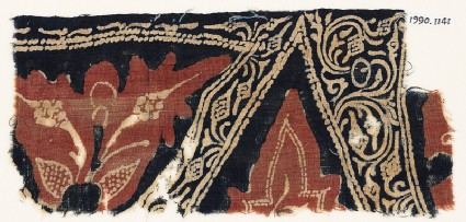 Textile fragment with stylized leaves, tendrils, and bunches of fruit