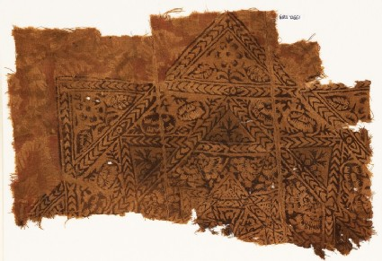 Textile fragment with star, chevrons, and flowers