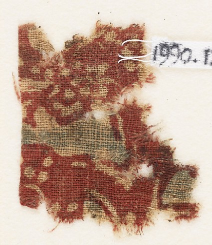 Textile fragment, probably with floral design