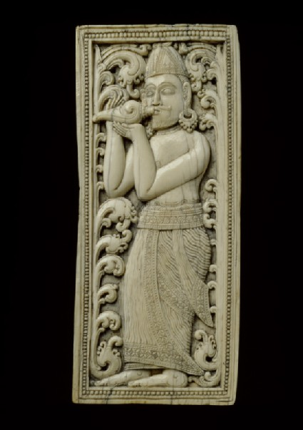 Ivory plaque with conch-blower