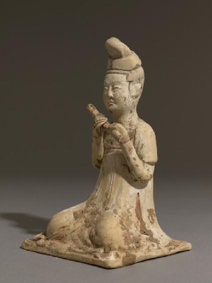 Figure of a flautist