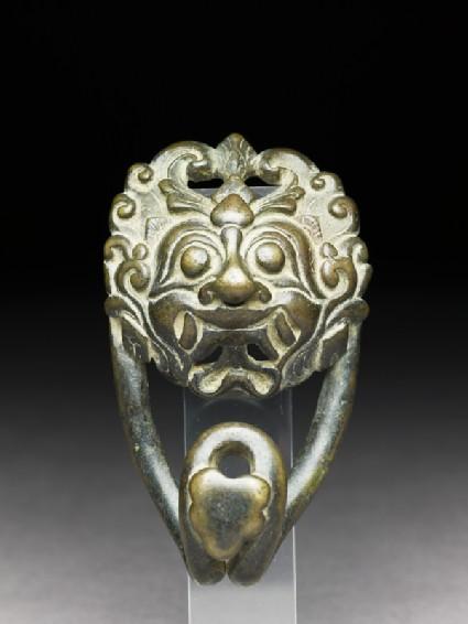 Bronze belt clasp with demon face