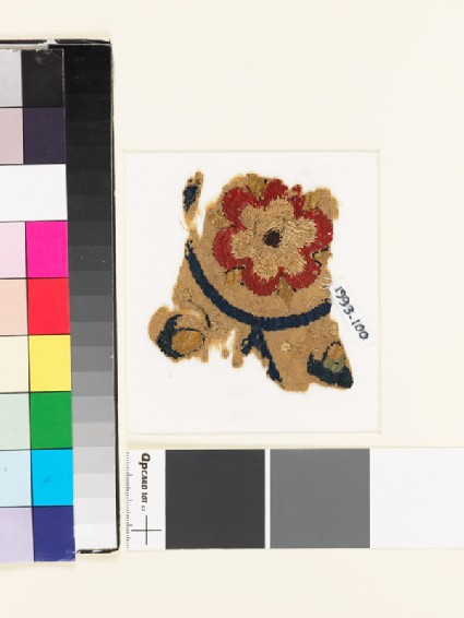 Textile fragment with rosette and remains of buds or foliage