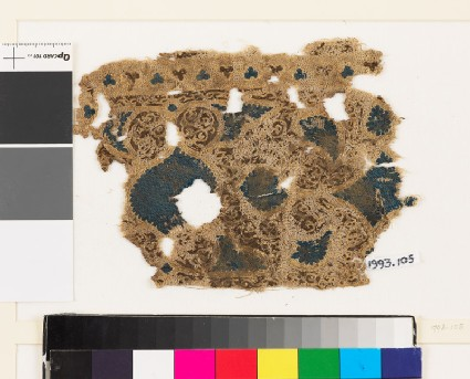 Textile fragment with swirling vegetal pattern and trefoil shapes