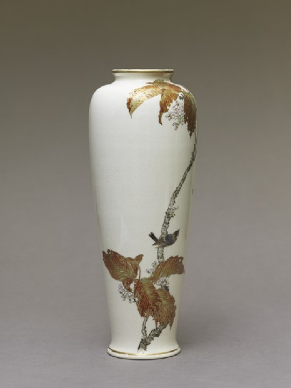 Satsuma style vase depicting a bird perched on a cherry tree