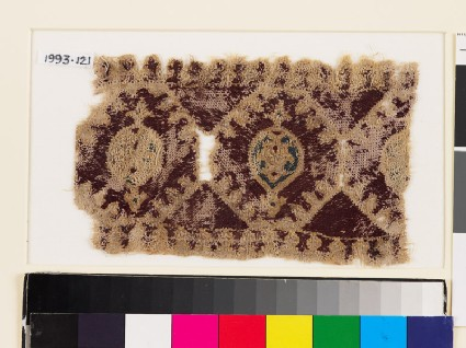 Textile fragment with linked octagons and medallions