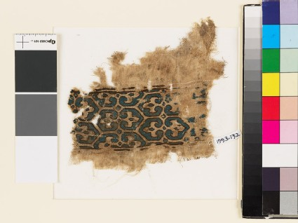 Textile fragment with pairs of palmettes and hexagons