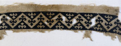 Textile fragment with band of chevrons and trefoil finials
