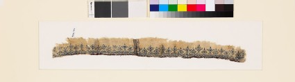 Textile fragment with stylized plants and pseudo-inscription