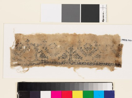 Textile fragment with stylized pairs of birds, trees, and pseudo-kufic inscription