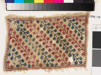 Textile fragment with stems and pairs of stylized leaves