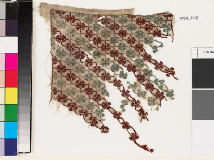 Textile fragment with quatrefoils and stems