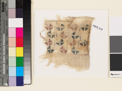 Textile fragment with geometric flowers and stems