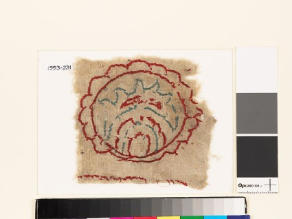 Textile fragment with multi-petalled circle and leaf