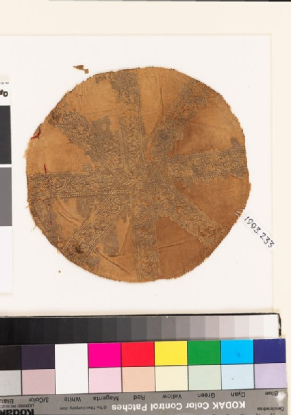 Roundel textile fragment with scrolling stems, trefoils, leaves, and star