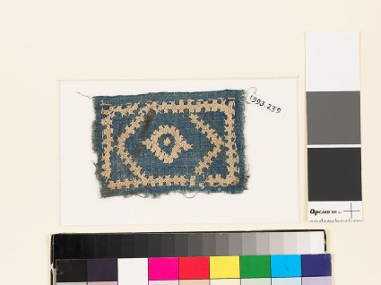 Textile fragment with diamond-shape, hexagon, rectangle, and linked crosses