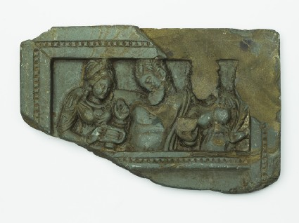 Lid or palette with the drunken Heracles supported by two female attendants