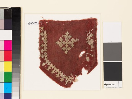 Textile fragment from a tab with a cross, shield-shape, and linked crosses
