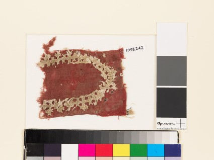Textile fragment with shield-shape of linked crosses