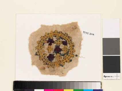 Roundel textile fragment with crosses and linked crosses