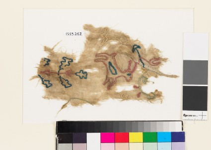 Textile fragment from a garment with deer, plant, flower-heads, and bird