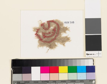 Textile fragment with leaf and crescent